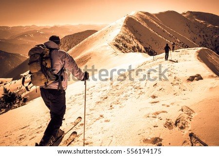 Skialpinists group in european alps, group skialpinists on snowy mountains, background skialpinism, group of skiers on mountain top