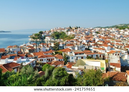SKIATHOS, GREECE - SEPTEMBER 28, 2012: Looking down onto Skiathos Town and harbour on the Greek island of Skiathos. The island was the location for several scenes in the popular 2008 film Mamma Mia. - stock photo