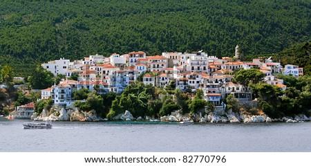 Skiathos island of Greece Sporades Mediterranean sea, view. Houses, ships and trees - stock photo