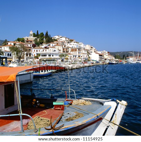 Skiathos port Greece with fishing boat in foreground