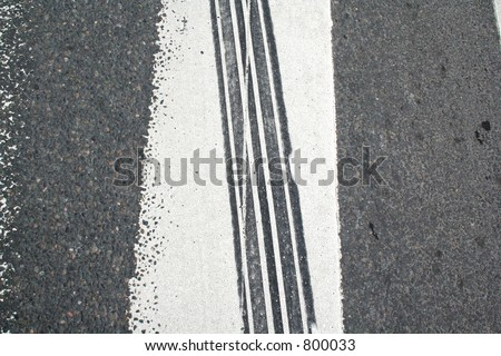 Skid mark on a zebra crossing - stock photo