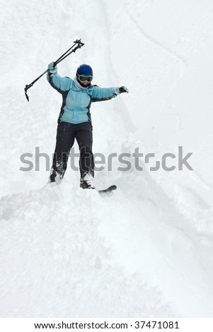 Skier coming down on an off-piste slope with fresh snow
