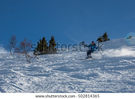 Skier descend from the mountains in the Alpine resort