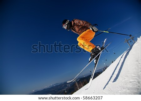 Skier girl jumping over blue sky - stock photo
