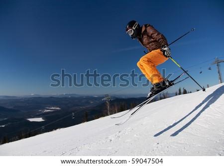 Skier girl jumping over blue sky - stock photo