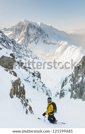 Skier in couloir with Mont Blanc as background
