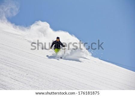 Skier in deep powder, extreme freeride - stock photo