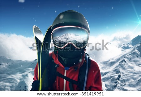 Skier in front of mountain landscape - stock photo
