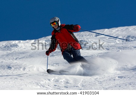 Skier in helmet rush at full speed - stock photo