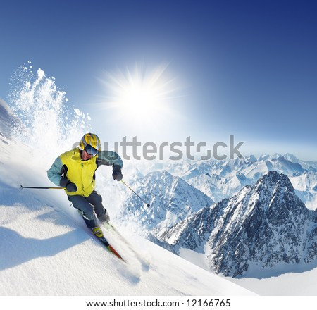 Skier in high mountains - stock photo