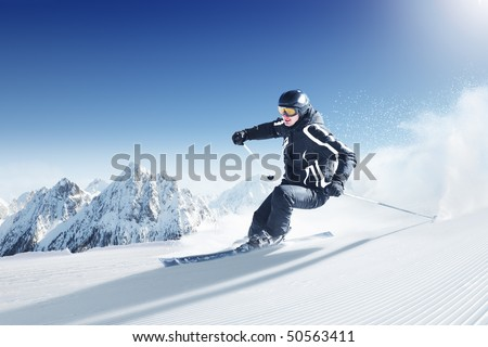Skier in high mountains - alpine - stock photo