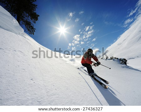 Skier in mountains - stock photo