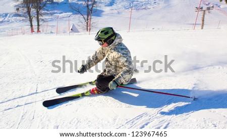Skier in the rotation at the ski resort - stock photo