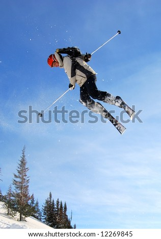 Skier jumping high in the air - stock photo