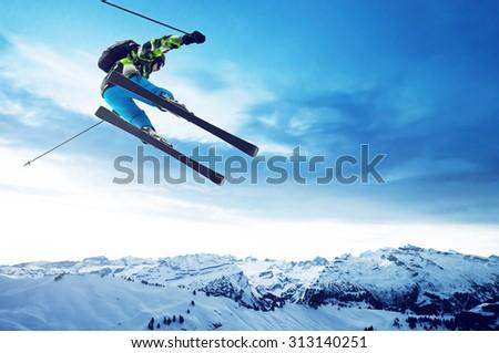 Skier jumps - stock photo