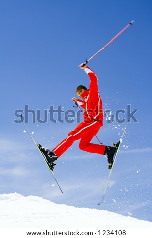 Skier jumps in the air - professional - stock photo