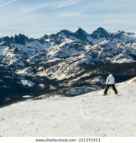 Skier looking out at Minarets range in Mammoth Lakes, CA - stock photo