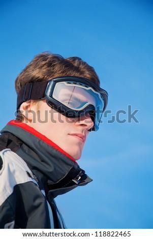 Skier man portrait sky background - stock photo