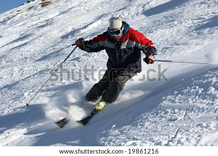 Skier moving down at full speed - stock photo