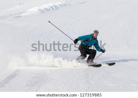 Skier moving down on ski