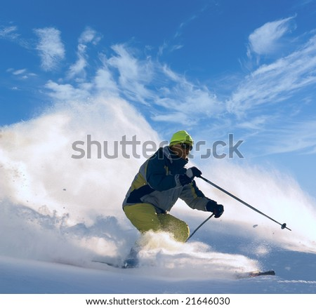 skier moving down on ski slope - stock photo