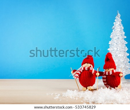 Skier on a snowy field and the Christmas trees