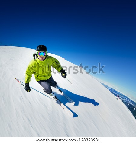 Skier on pise in high mountains - stock photo