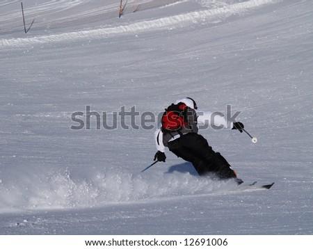 Skier on the ski slope. - stock photo