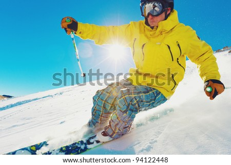 Skier Racing Down the Mountain, with Motion Blur - stock photo