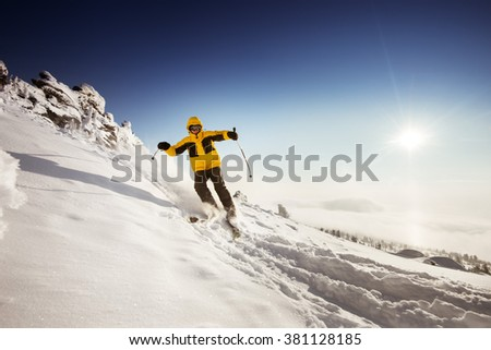 Skier rides on the slope. Sheregesh resort, Siberia, Russia. Space for text - stock photo