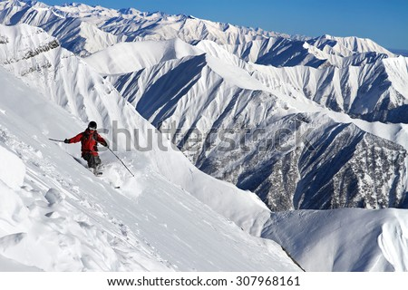Skier riding from the high mountains - stock photo