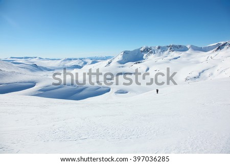 Skier roll on skis in Altai mountains