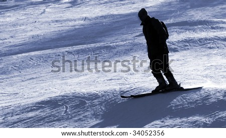 Skier silhouette - monochrome photo - stock photo