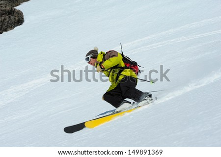Skier skidding in the virgin snow, off piste. - stock photo
