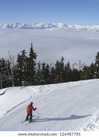 Skier takes a corner at on mountain in Whistler, Canada - stock photo
