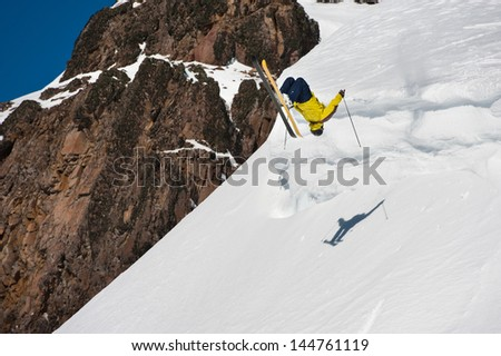 Skier turning on the air in snow cornices.