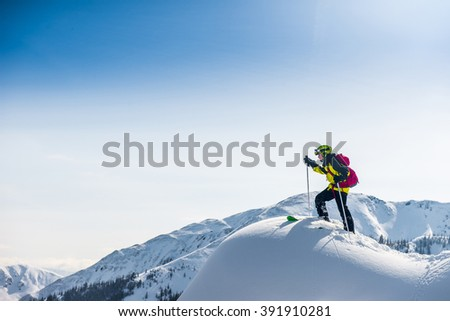 Skier walking on top of the mountain. - stock photo