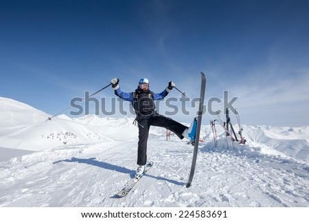 Skier warms up before descent from high winter mountain in Gudauri, Georgia - stock photo