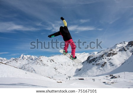 Skiers and snowboarders enjoying the snow park at Tignes Espace Killy France