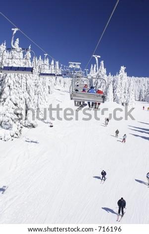 skiers enjoying the slopes - stock photo