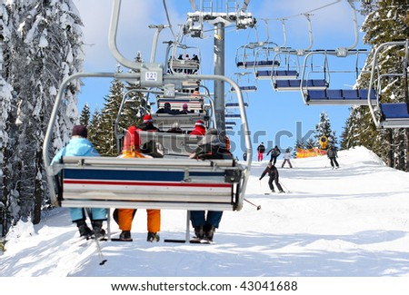 Skiers go on the lift on mountain in Bukovel, Ukraine - stock photo