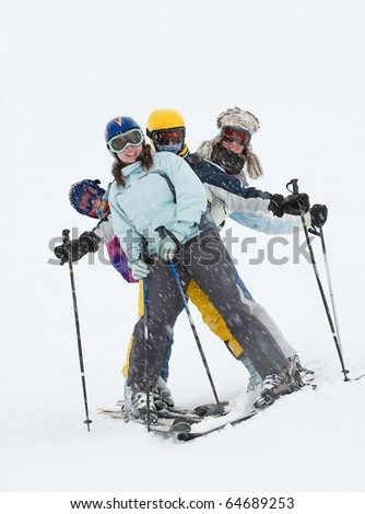 Skiers having fun in the blizzard