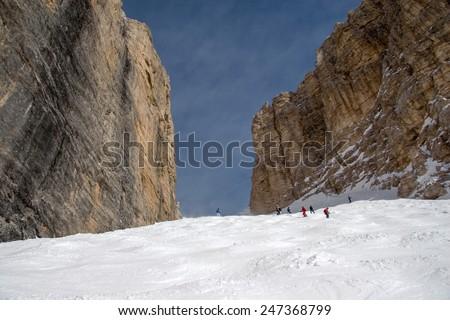 Skiers in Sass Pordoi slope / Val di Fassa, Sella Ronda, Dolomites, Italy - stock photo