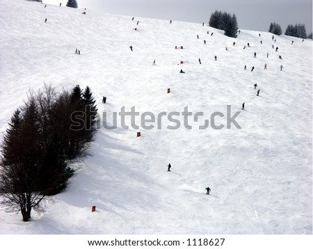 Skiers on downhill slope - stock photo