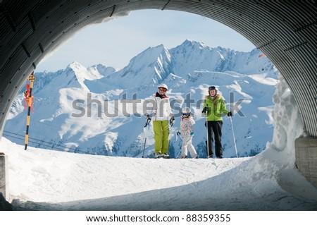 Skiers on ski slope - stock photo