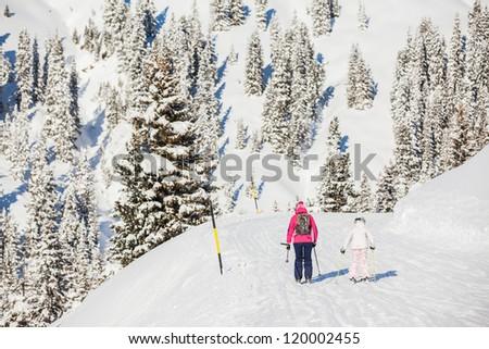 Skiers on the Alpine skiing resort in Austria Zillertal - stock photo
