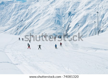 Skiers on the mountain slope - stock photo