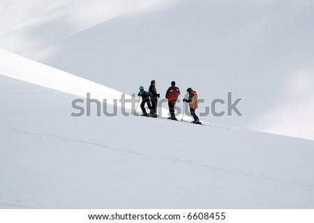 Skiers on the top of mountain. - stock photo