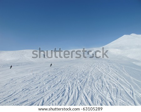 Skiers on wide open piste in French alps. Chamonix. - stock photo