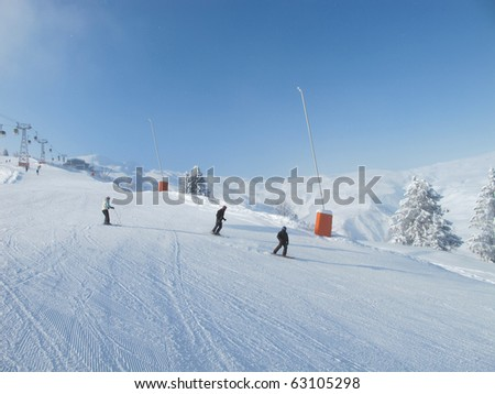 Skiers on wide ski slope on sunny day. Blue sky, Chamonix . French alps. - stock photo